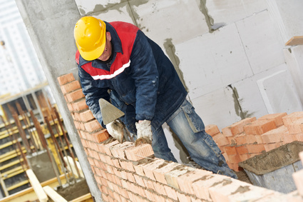 Man Laying Brick and mortar